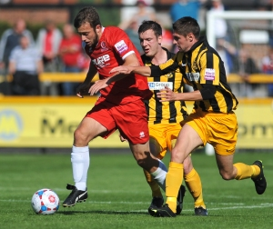 Captain Gallagher in action against Southport. Photo courtesy of Dave Budden/Newsshopper.co.uk